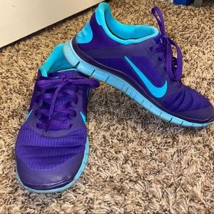 Purple and teal sneakers